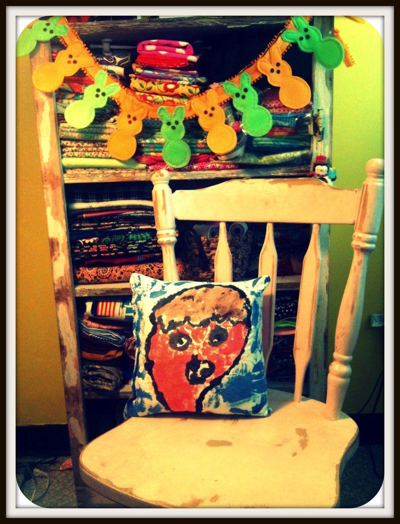 Jacks portrait pillow in chair