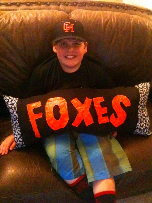 Foxes pillow sit on couch